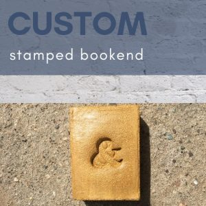 thumbnail for a concrete initial bookend stamped with an ampersand