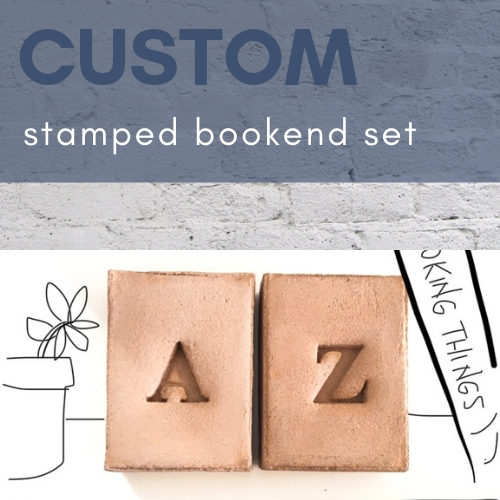 the letters a and z stamped into a concrete bookend set