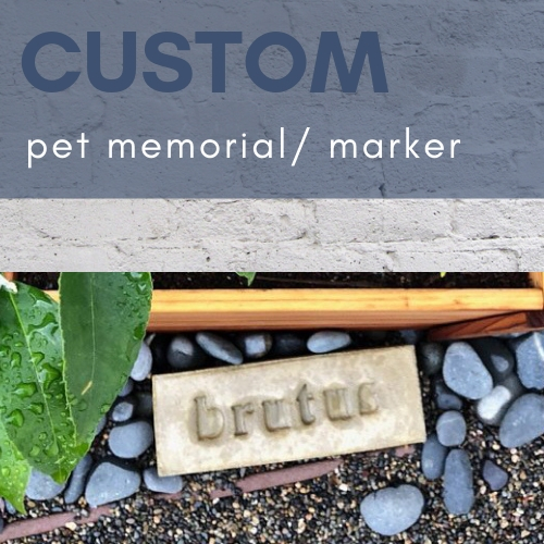 pet memorial brick with brutus stamped in it resting under a tree