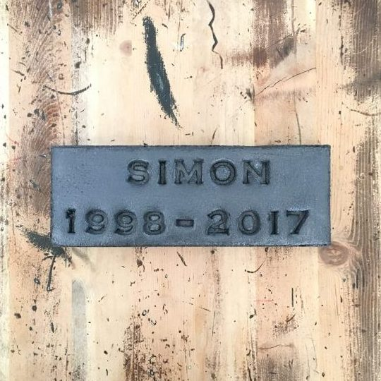 simon 1998-2017 stamped into a custom concrete brick