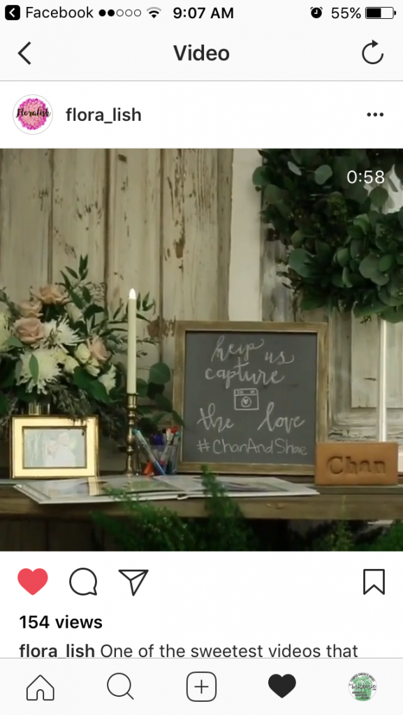 screenshot of a wedding video with a chan brick on the sign in table